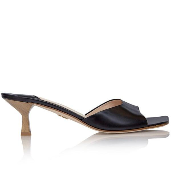<p>Kitten heels are popping up everywhere right now, and we like this <span>Brother Vellies Midnight Tuesday Mule</span> ($455). It'll go with just about any outfit you can dream up.</p>