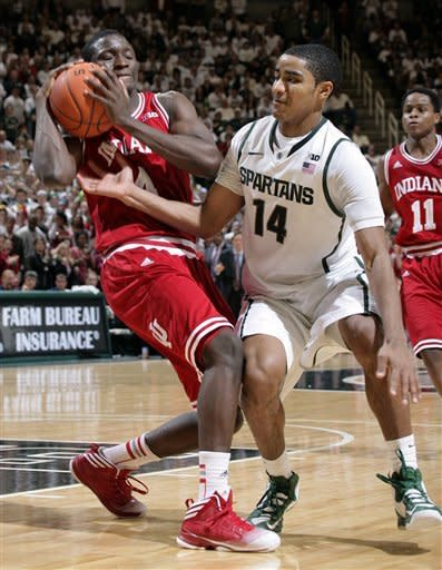 Indiana's Victor Oladipo, left, is fouled by Michigan State's Gary Harris (14) after Oladipo collected a rebound off a missed free throw by Harris in the final seconds of an NCAA college basketball game, Tuesday, Feb. 19, 2013, in East Lansing, Mich. Indiana won 72-68. (AP Photo/Al Goldis)