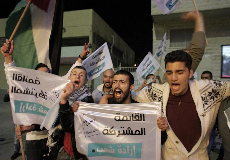 Supporters of the Joint List of Arab parties react to exit poll figures at the party's headquarters in the city of Nazareth on March 17, 2015 (AFP Photo/Ahmad Gharabli)