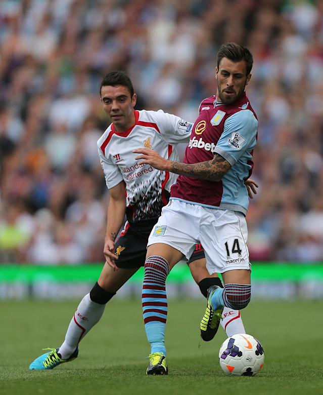Liverpool's Iago Aspas (left) and Aston Villa's Antonio Luna (right) battle for the ball