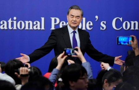 China's Foreign Minister Wang Yi speaks to the media after a news conference during the National People's Congress (NPC), China's parliamentary body, in Beijing, China March 8, 2018. REUTERS/Jason Lee