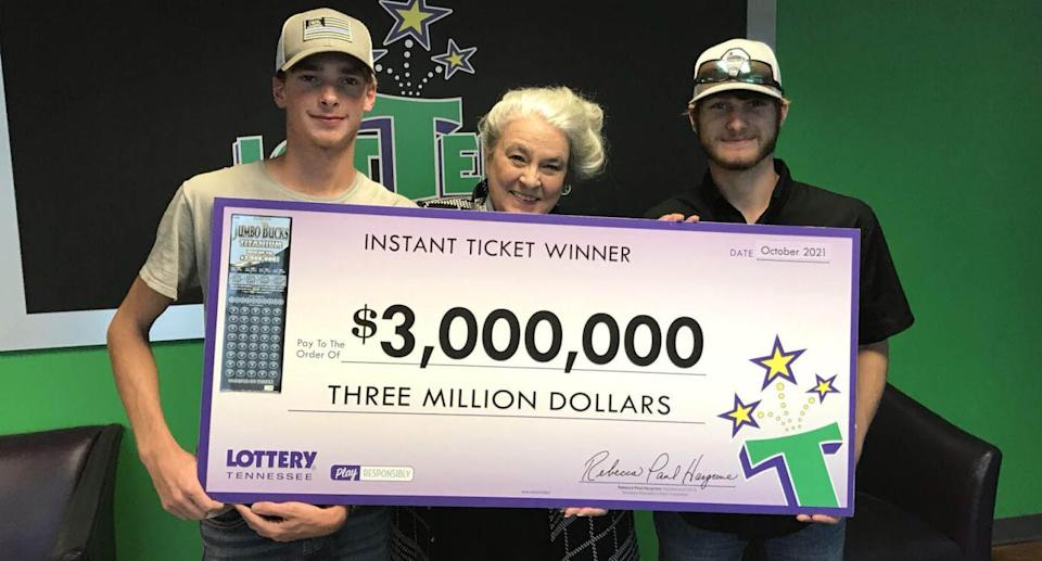 Wyatt Close and Brandon Thompson are pictured with a lottery cheque.