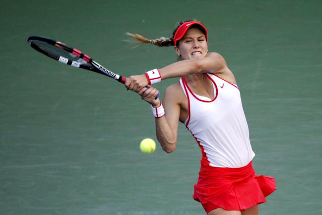 Eugenie Bouchard of Canada hits a return to Dominika Cibulkova of Slovakia during their women's singles third round match at the U.S. Open Championships tennis tournament in New York, September 4, 2015. REUTERS/Mike Segar