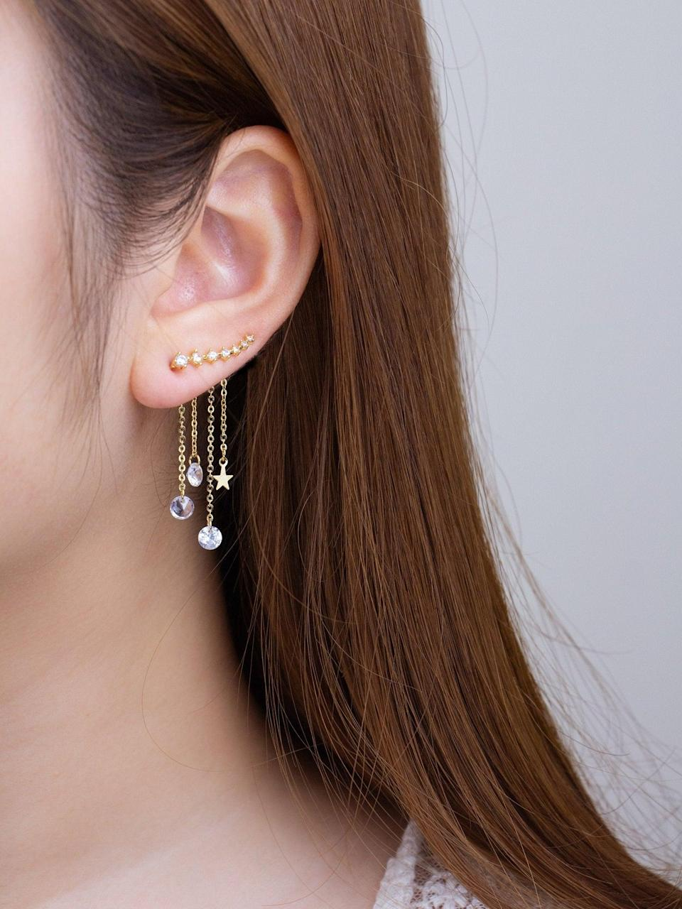 <p>We're absolutely in love with these unique <span>Two-Way Gold Star Ear Climber Earrings With Crystal Chain</span> ($15, originally $21). It's so glamorous and whimsical. They can wear the ear climber by itself or with the drop detailing.</p>