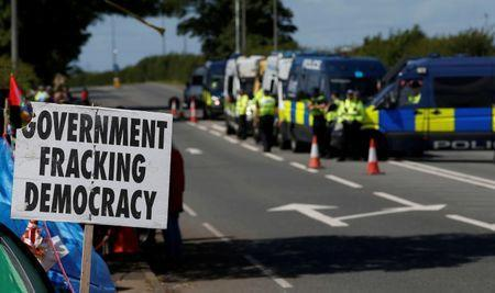 FILE PHOTO: An anti-fracking sign is seen outside Cuadrilla's Preston New Road fracking site near Blackpool, Britain, 31 July, 2017. REUTERS/Andrew Yates/File Photo