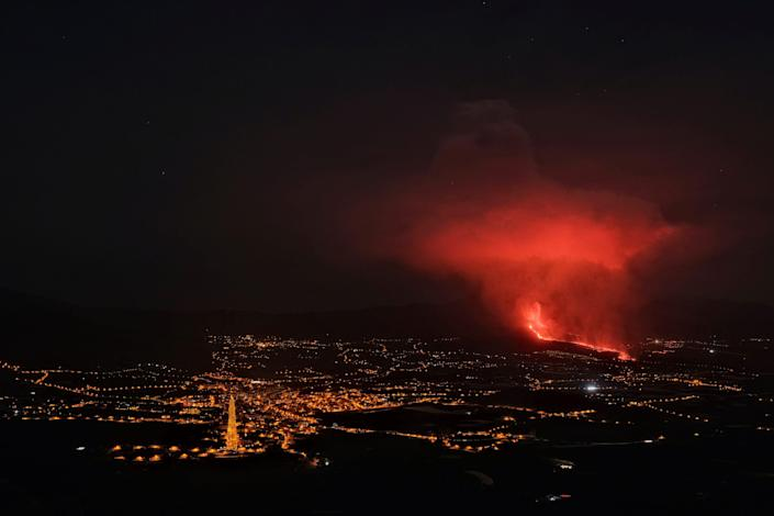 Lava spews from a volcano on the Canary island of La Palma, Spain in the early hours of Saturday Sept. 25, 2021. A volcano in Spain's Canary Islands is keeping nerves on edge several days since it erupted, producing loud explosions, a huge ash cloud and cracking open a new fissure that spewed out more fiery molten rock.