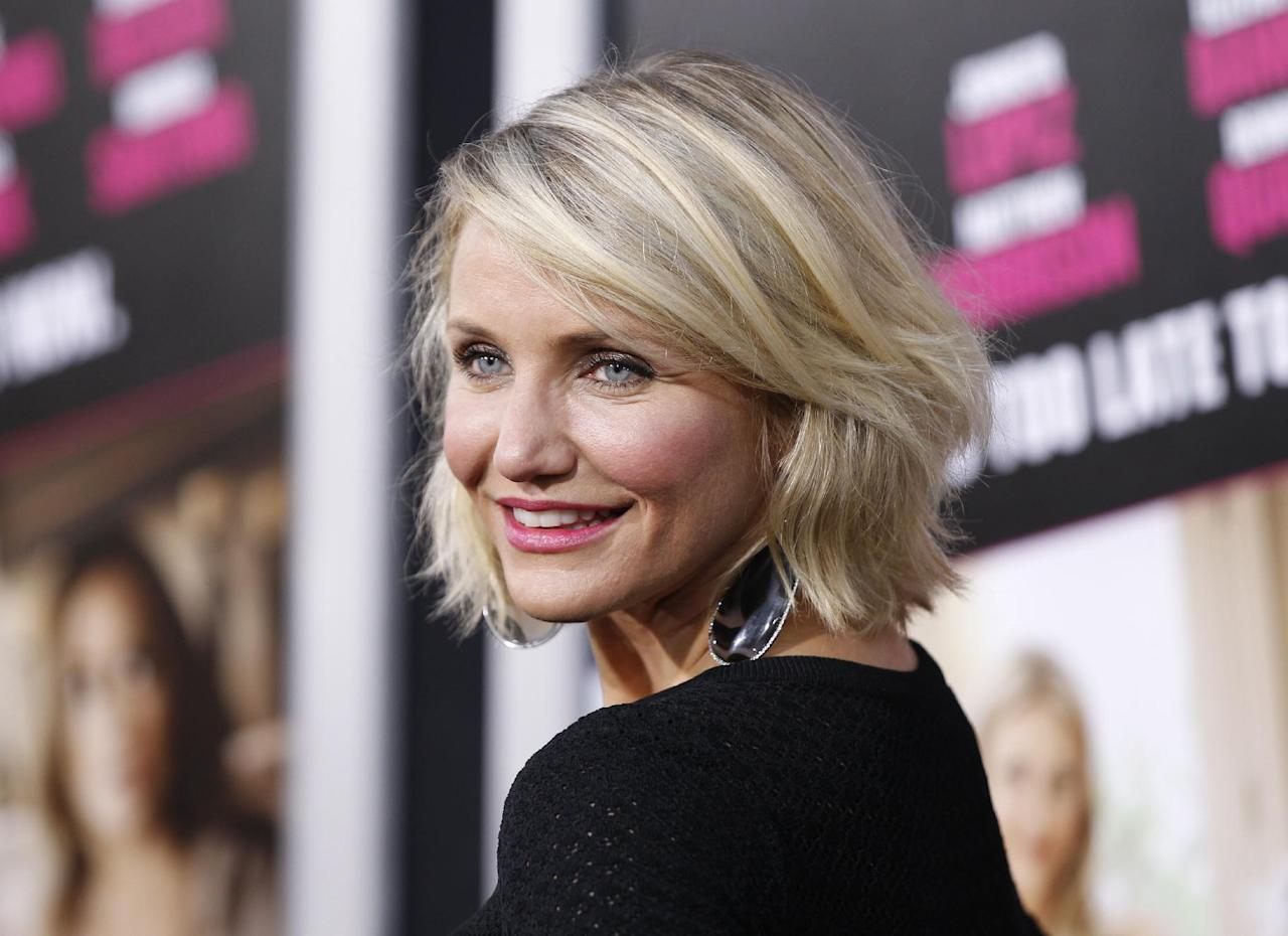 """FILE - In this May 14, 2012 file photo, Cast member Cameron Diaz poses at the Los Angeles premiere of the film """"What to Expect When You're Expecting,"""" in Los Angeles. HarperCollins announced Wednesday, Aug. 8, 2012 that the star of """"Charlie's Angels,"""" ''There's Something About Mary"""" and other films has an agreement with the publisher for a book on health and wellness. Diaz's book is currently untitled and scheduled for publication in the fall of 2013. (AP Photo/Danny Moloshok, File)"""