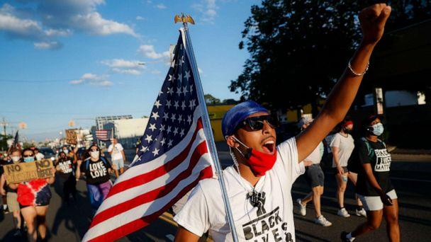 PHOTO: Protesters chant as they pass down a main thoroughfare during a Black Lives Matter march through a residential neighborhood calling for racial justice, July 13, 2020, in Valley Stream, N.Y. (John Minchillo/AP)