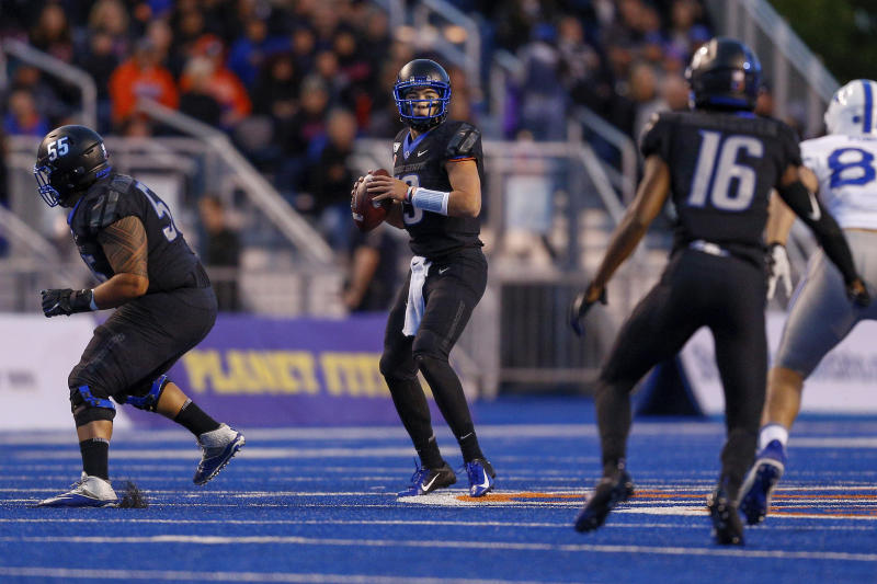 Boise State quarterback Hank Bachmeier, center, looks downfield against the Air Force defense in the first half of an NCAA college football game, Friday, Sept. 20, 2019, in Boise, Idaho. (AP Photo/Steve Conner)