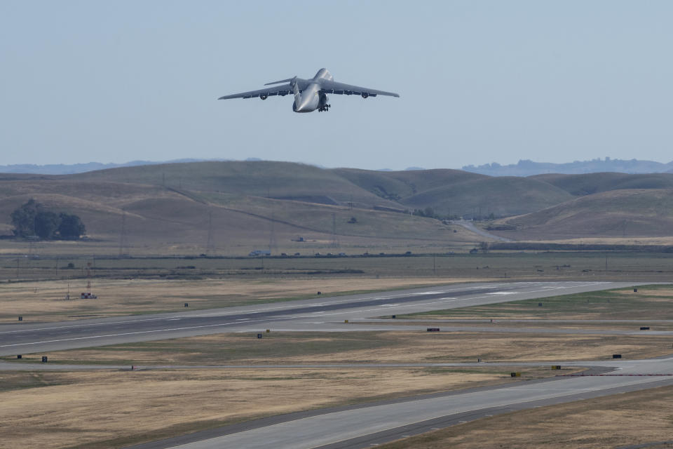 In this photo provided by the U.S. Air Force, a C-5M Super Galaxy, carrying critical medical supplies, takes off Wednesday, April 28, 2021, from Travis Air Force Base, Calif., for a non-stop flight to India. The United States is donating medical supplies to assist the country of India in its ongoing fight against COVID-19. The donation consisted of 440 oxygen cylinders and regulators, one million N-95 masks and one million COVID-19 rapid diagnostic kits. (Cameron Otte/U.S. Air Force via AP)
