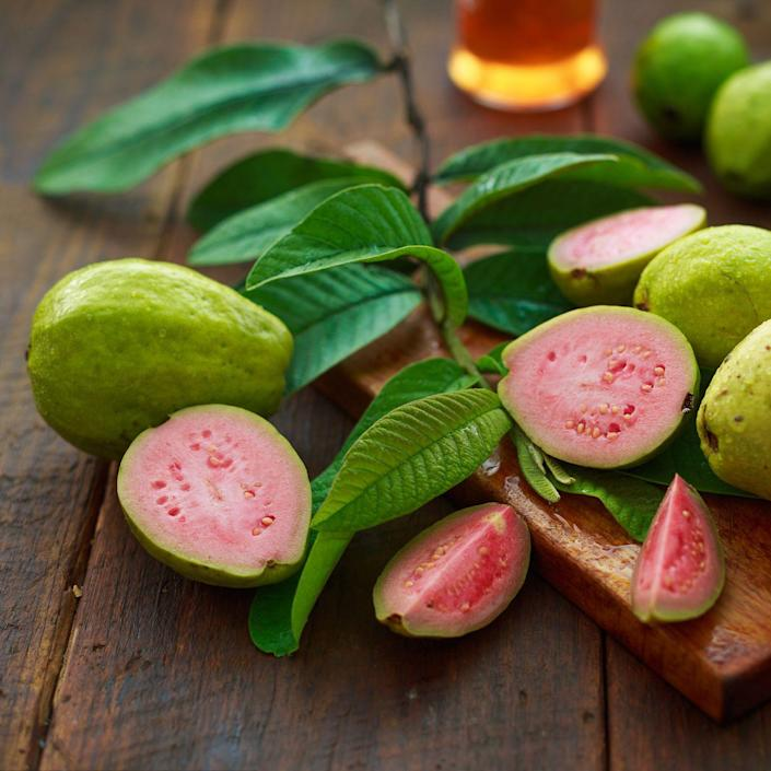 """<p>Native to South America, this tropical fruit is an excellent source of skin-healing vitamin C, with 250 percent of your RDA per serving. One cup of guava has nearly 5 times as much vitamin C as a medium orange (377 milligrams versus 83 milligrams)—that's more than five times your daily need. Guava makes a delicious fruit smoothie: Blend 1/2 banana, 1/2 ripe guava, a handful of strawberries, 1/2 cup unsweetened soy milk, and a few ice cubes. Check out these delicious<a href=""""https://www.prevention.com/food-nutrition/a20499756/20-super-healthy-smoothie-recipes/"""" rel=""""nofollow noopener"""" target=""""_blank"""" data-ylk=""""slk:smoothies recipes"""" class=""""link rapid-noclick-resp""""> smoothies recipes</a>. </p>"""