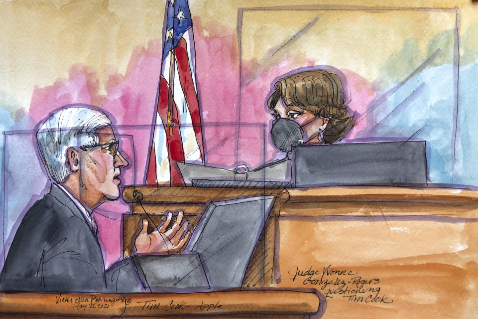 This courtroom sketch shows Apple CEO Tim Cook being questioned by U.S. District Court Judge Yvonne Gonzalez Rogers during a trial in San Ramon, Calif., on Friday, May 21, 2021. Cook described the company's ironclad control over its mobile app store as a way to keep things simple for customers while protecting them against security threats and privacy intrusions during Friday testimony denying allegations he has been running an illegal monopoly. The rare courtroom appearance by one of the world's best-known executives came during the closing phase of a three-week trial revolving an antitrust case brought by Epic Games, maker of the popular video game Fortnite. (Vicki Behringer via AP)