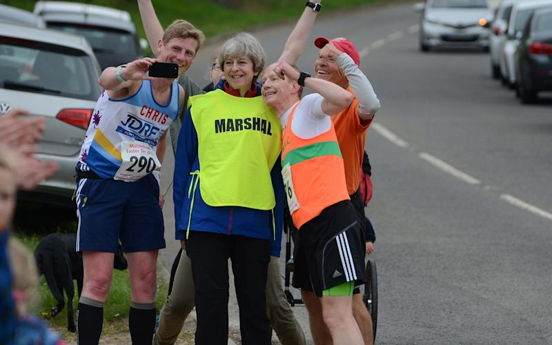 Her job was to point runners in the right direction - but some were distracted and stopped for a selfie - © Baylis Media/Solent News & Photo Agency