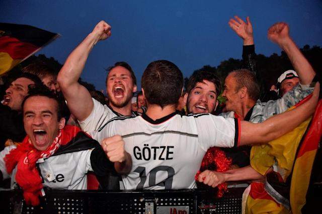 Germany supporters in Berlin were in ecstasy after their team salvaged their World Cup chances (AFP Photo/John MACDOUGALL)