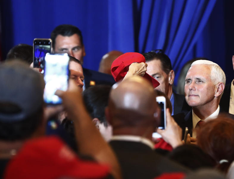 Vice President Mike Pence speaks to constituents after speaking during a rally on Tuesday, June 25, 2019 in Miami. (AP Photo/Brynn Anderson)
