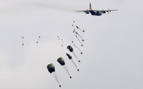 A C-130 Hercules aircraft drops supplies during Han Kuang military drill simulating the China's People's Liberation Army (PLA) invading the island - Credit: TYRONE SIU/REUTERS