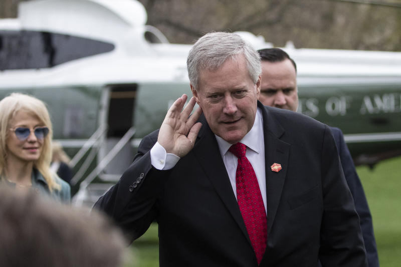 Acting White House Chief of Staff Mark Meadows holds his hand to his ear to hear a question after stepping off Marine One as they return to the White House, Saturday, March 28, 2020, in Washington. President Donald Trump is returning from Norfolk, Va., for the sailing of the USNS Comfort, which is headed to New York. (AP Photo/Alex Brandon)