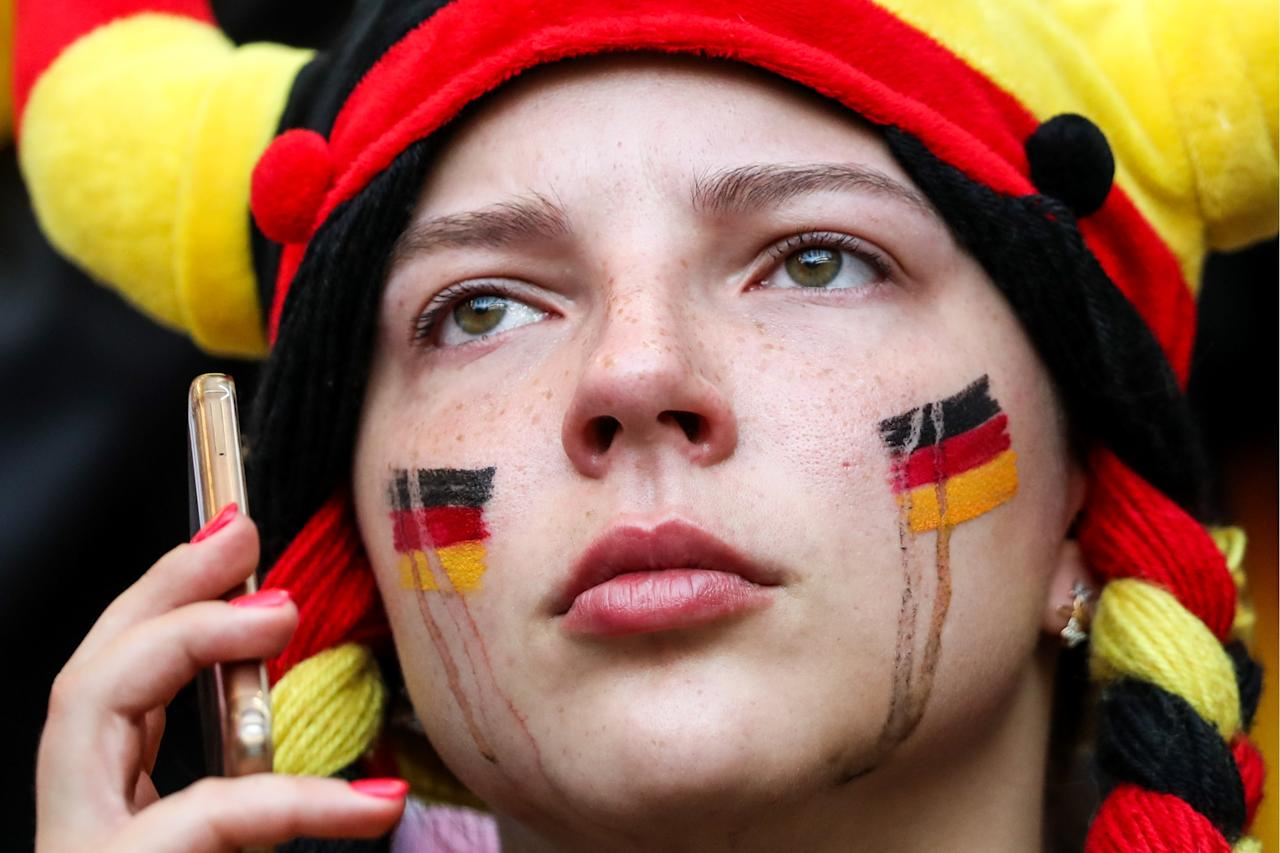 <p>A German football fan after her team's 2018 FIFA World Cup Group F match against South Korea at Kazan Arena Stadium; South Korea wins 2-0. Sergei Savostyanov/TASS (Photo by Sergei Savostyanov\TASS via Getty Images) </p>