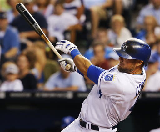 Kansas City Royals' Alex Gordon hits a grand slam off Cleveland Indians starting pitcher Corey Kluber during the fifth inning of a baseball game at Kauffman Stadium in Kansas City, Mo., Tuesday, July 2, 2013. (AP Photo/Orlin Wagner)