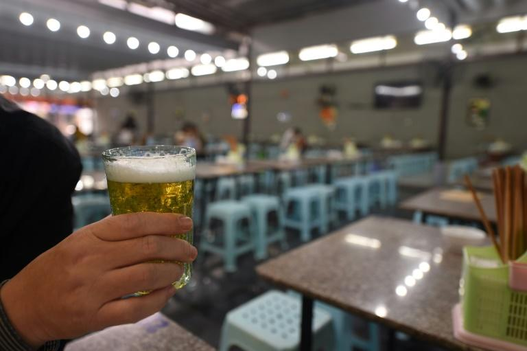 Many Vietnamese stop off at their favourite bar for a few glasses of beer after work