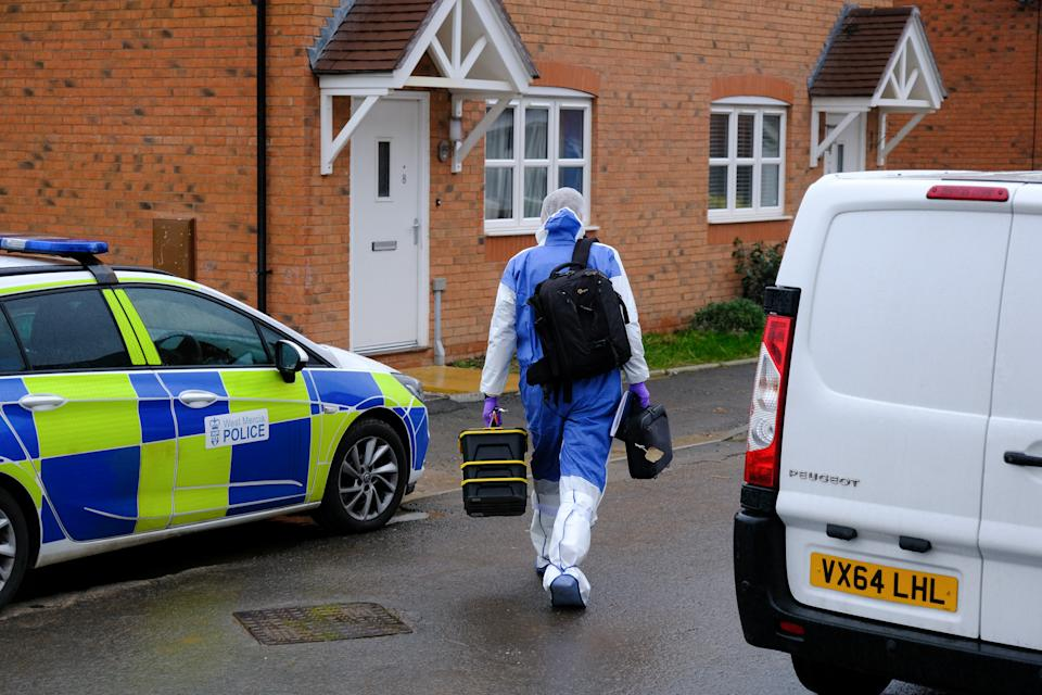 A police forensics officer arrives at the property. (SWNS)