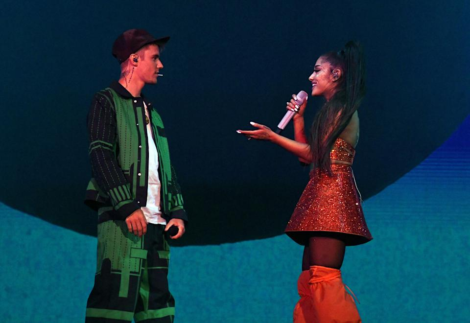 Justin Bieber (L) has defended his Coachella performance with Ariana Grande after a television personality ridiculed him for lip-syncing (Kevin Mazur/Getty Images for AG)