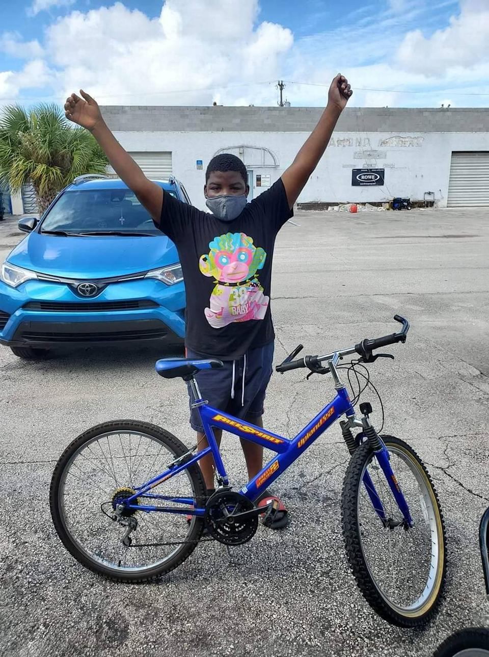 One happy recipient with his donated bike from Recyclable Bicycle Exchange, a Fort Lauderdale nonprofit.