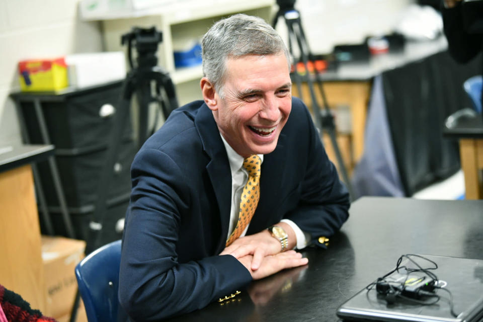 FILE - In this Feb. 21, 2019 file photo, U.S. Rep. Tom Rice, R-Myrtle Beach, laughs while talking with students at Brockington Elementary School during U.S. Secretary of Education Betsy DeVos' visit to Timmonsville, S.C. South Carolina Republicans on Saturday, Jan. 30, 2021 are expected to formally censure Rice, who was among 10 GOP representatives to support the second impeachment of Donald Trump. (AP Photo/Meg Kinnard, File)