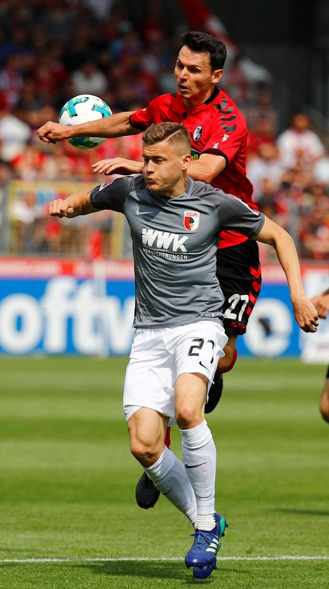 Soccer Football - Bundesliga - SC Freiburg v FC Augsburg - Schwarzwald-Stadion, Freiburg, Germany - May 12, 2018 SC Freiburg's Nicolas Hofler in action with Augsburg's Alfred Finnbogason REUTERS/Kai Pfaffenbach DFL RULES TO LIMIT THE ONLINE USAGE DURING MATCH TIME TO 15 PICTURES PER GAME. IMAGE SEQUENCES TO SIMULATE VIDEO IS NOT ALLOWED AT ANY TIME. FOR FURTHER QUERIES PLEASE CONTACT DFL DIRECTLY AT + 49 69 650050