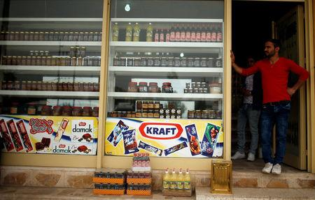 A man stands outside a shop in Zakho near the Iraqi-Turkish border Iraq