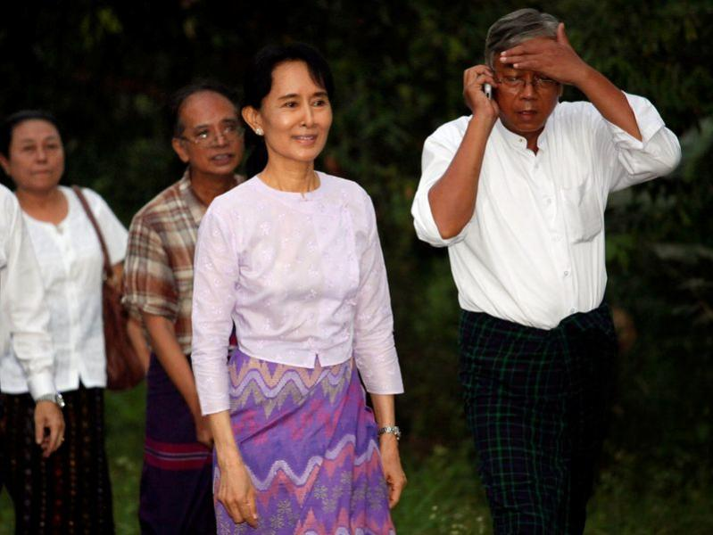 FILE PHOTO: Aung San Suu Kyi walks with National League for Democracy party members after being released from house arrest in Yangon