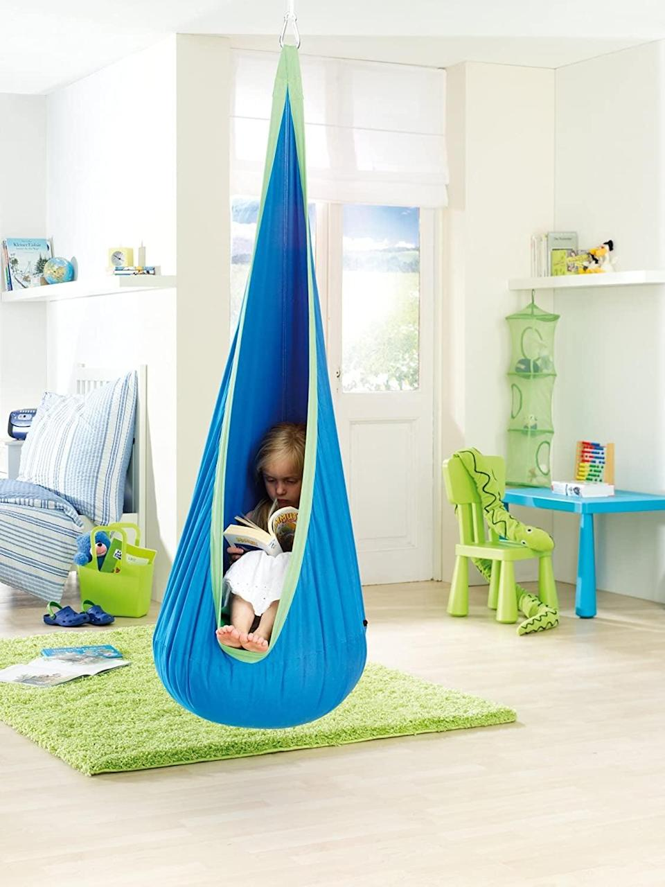 <p>Encourage toddlers to relax, read, or play in this <span>Sensory Jungle Hanging Pod Chair with Cushion</span> ($38). These durable swinging chairs can be mounted inside or outside, and help kids calm down by block sensory input.</p>