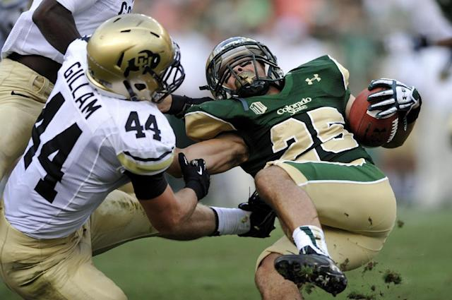 Colorado State wide receiver Joe Hansley (25) is tackled by Colorado linebacker Addison Gillam (44) during the second quarter of an NCAA college football game Sunday, Sept. 1, 2013, in Denver. (AP Photo/Jack Dempsey)