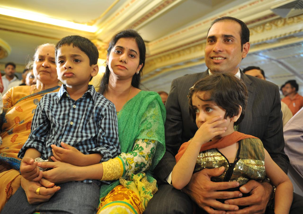Indian cricketer Vangipurappu Venkata Sai (VVS) Laxman (R), wife Sailaja amd their children Sarvajith and Achinthya attend a press conference held to announce his retirement from Test Cricket at the Rajiv Gandhi International cricket stadium in Hyderabad on August 18, 2012. Veteran Indian batsman Vangipurappu Venkata Sai Laxman announced his retirement from international cricket on Saturday, saying it was time to make way for the next generation.   AFP PHOTO / Noah SEELAM
