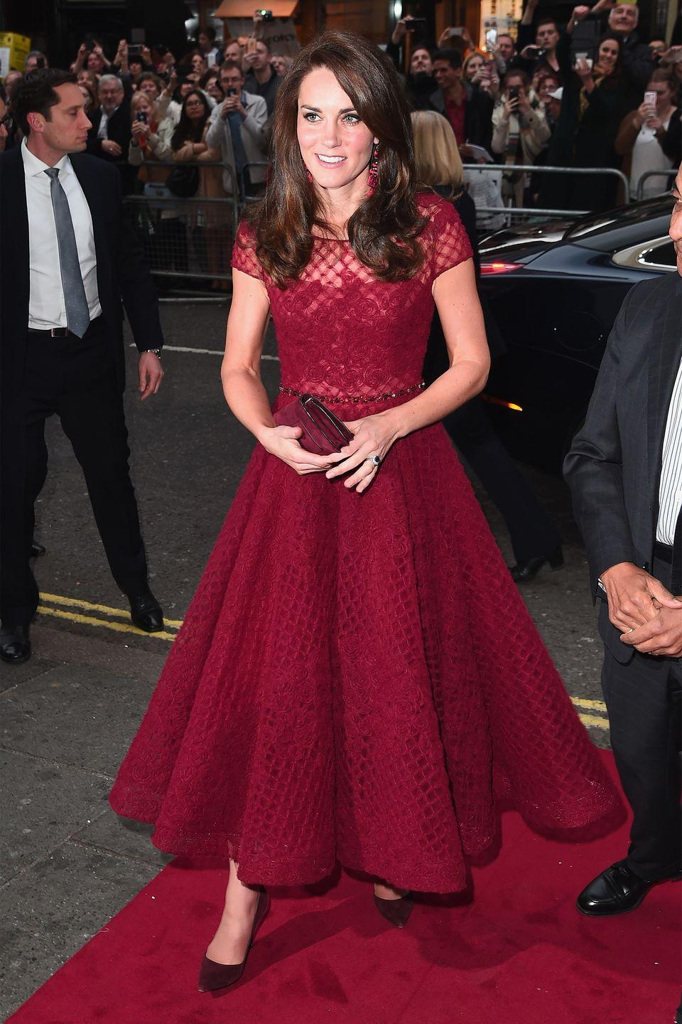 <p>In a red Marchesa dress, pumps and clutch at the opening of '42nd Street' at the West End.</p>
