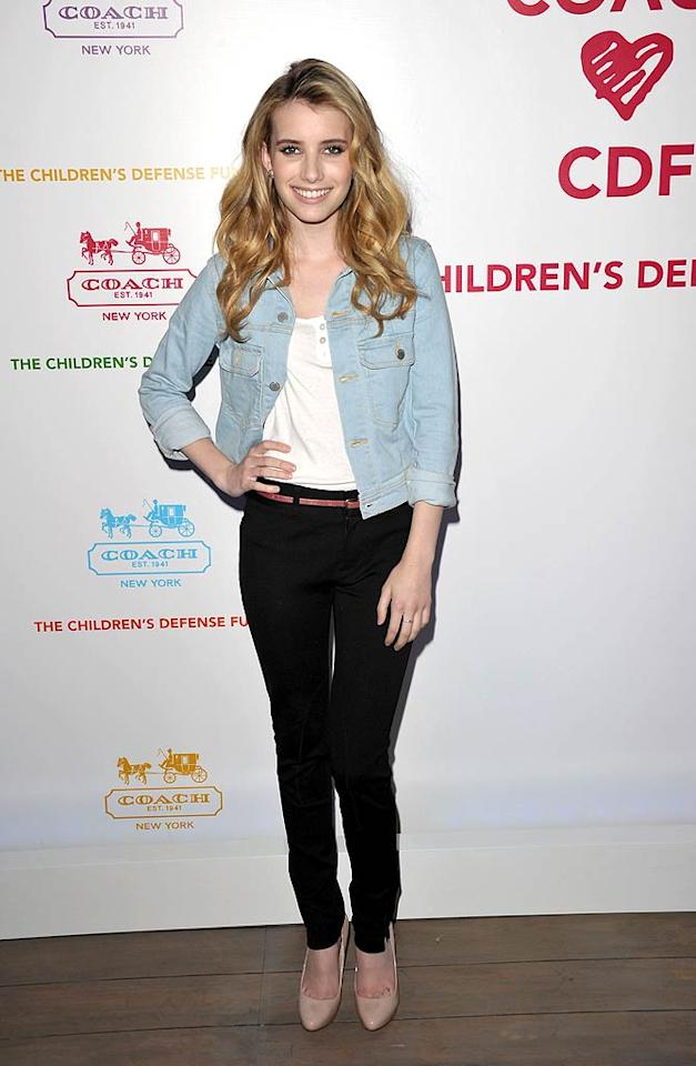 """""""Scream 4"""" actress Emma Roberts dressed down in an Elizabeth & James/TEXTILE denim jacket, white Enza Costa top, Vince jeans, nude Miu Miu pumps, and a Louis Vuitton bag. John Shearer/<a href=""""http://www.gettyimages.com/"""" target=""""new"""">GettyImages.com</a> - April 20, 2011"""