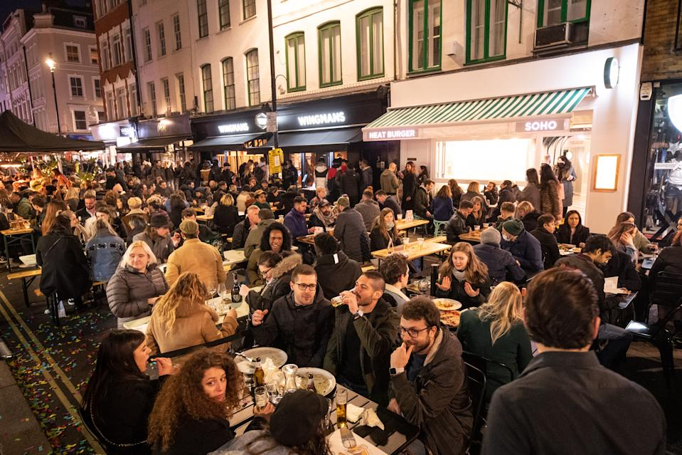People gather in Soho, London, where streets were closed to traffic as bars and restaurants opened for outside eating and drinking, as lockdown measures are eased across the UK. Picture date: Tuesday April 13, 2021. Photo credit should read: Matt Crossick/Empics