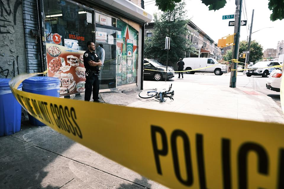 Police converge on the scene of a shooting in Brooklyn, one of numerous during the day, on July 14, 2021 in New York City. (Spencer Platt/Getty Images)