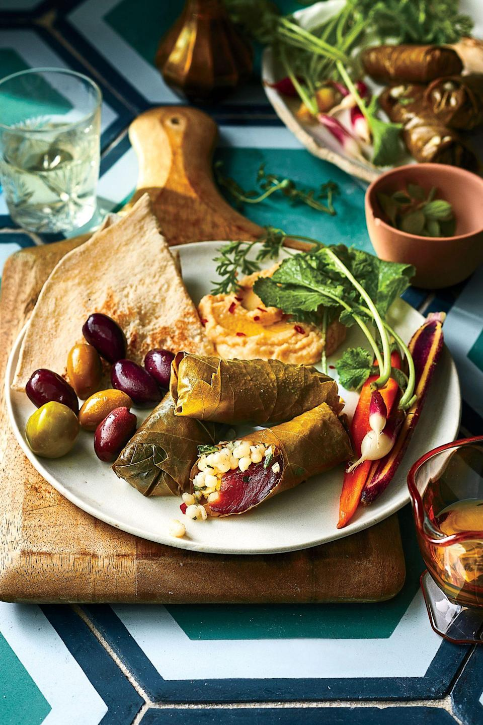 """<p>Our variation on dolmas (think Mediterranean spring rolls) bundles fresh tuna, crunchy peppers, and <a href=""""https://www.myrecipes.com/t/pasta/couscous"""" rel=""""nofollow noopener"""" target=""""_blank"""" data-ylk=""""slk:tender couscous"""" class=""""link rapid-noclick-resp"""">tender couscous</a> stuffed into tangy grape leaves. Remember to gently remove the leaf bundles (available at most Mediterranean markets, Whole Foods, or Trader Joe's locations) from their jar, being careful not to tear the leaves.</p>"""