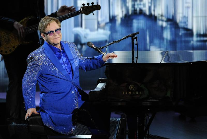 """Elton John performs """"Home Again"""" at the 65th Primetime Emmy Awards at Nokia Theatre on Sunday Sept. 22, 2013, in Los Angeles. (Photo by Chris Pizzello/Invision/AP)"""