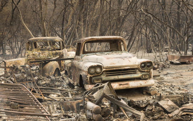 <p>Trucks burned by a wildfire rest in a grove near Oroville, Calif., on Saturday, July 8, 2017. The fast-moving wildfire in the Sierra Nevada foothills destroyed structures, including homes, and led to several minor injuries, fire officials said Saturday as blazes threatened homes around California during a heat wave. (AP Photo/Noah Berger) </p>