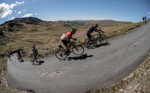 Robin Hough rides up the Lake District's infamously grueling Hardknott Pass - Credit: Steve Fleming/SteveFlemingPhoto.com
