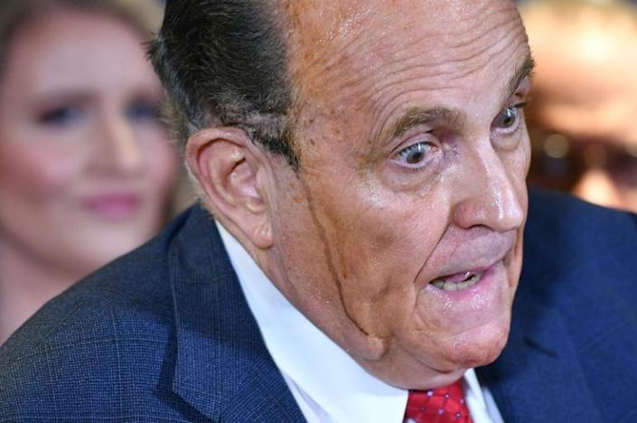 Trump's personal lawyer Rudy Giuliani sweats during a press conference at the Republican National Committee headquarters in Washington, DC
