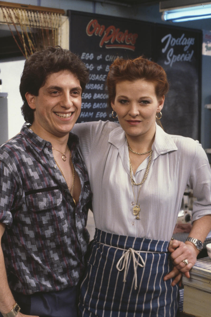 Actors Sandy Ratcliff and Nejdet Salih pictured on the set of the BBC soap opera 'EastEnders', 1985. (Photo by Don Smith/Radio Times/Getty Images)