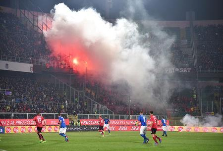 Football Soccer - Italy v Albania - World Cup 2018 Qualifiers - Group G - Renzo Barbera stadium, Palermo, Italy - 24/3/17. Albania's supporters light flares during the match. REUTERS/Alberto Lingria