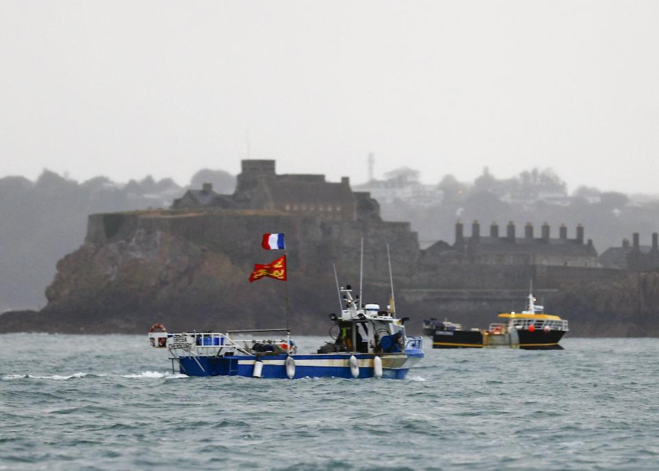 <strong>French fishing boats protest in front of the port of St Helier off the island of Jersey.</strong> (Photo: SAMEER AL-DOUMY via Getty Images)