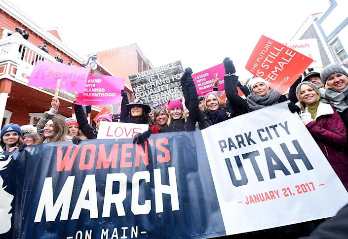 <p>Jennifer Beals, Chelsea Handler and Charlize Theron participates in the Women's March on Main Street Park City on January 21, 2017 in Park City, Utah. (Michael Loccisano/Getty Images) </p>