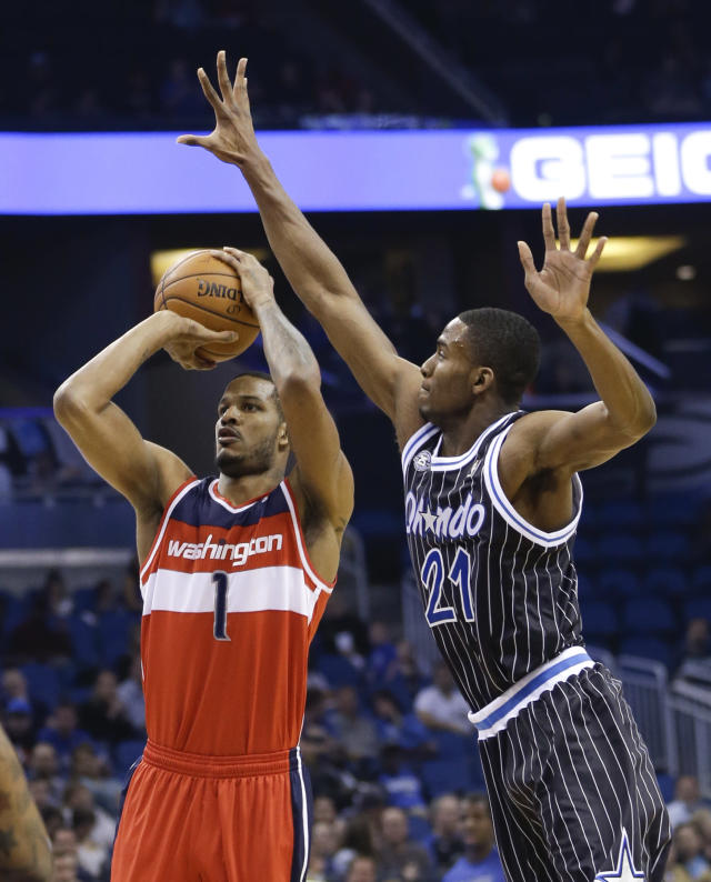Orlando Magic's Maurice Harkless (21) comes in to block a shot by Washington Wizards' Trevor Ariza (1) during the first half of an NBA basketball game in Orlando, Fla., Friday, March 14, 2014. (AP Photo/John Raoux)
