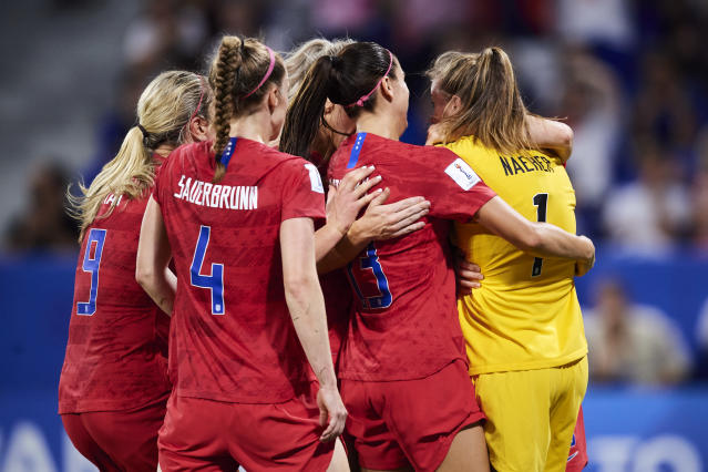 U.S. players mob Alyssa Naeher after her heroic penalty save in a Women's World Cup semifinal win over England. (Getty)