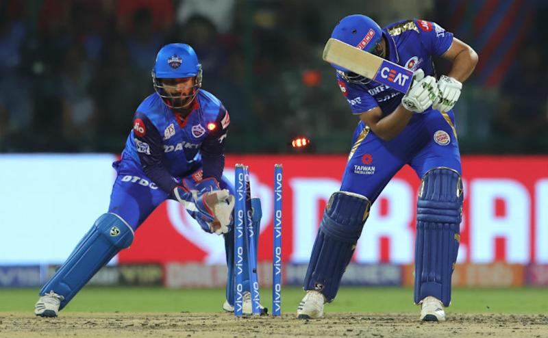 Rohit Sharma is clean bowled by Amit Mishra right after powerplay. Sportzpics